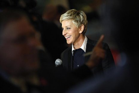 Ellen DeGeneres smiles as she talks to a reporter while arriving for the Mark Twain Prize ceremony in Washington, October 22, 2012. REUTERS/