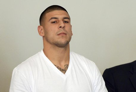 New England Patriots tight end Aaron Hernandez is arraigned on charges of murder and weapons violations in Attleborough, Massachusetts, afte