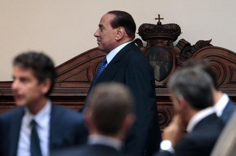 Former Italian Prime Minister Silvio Berlusconi leaves Palazzo Grazioli, his residence in Rome, August 2, 2013. REUTERS/Tony Gentile
