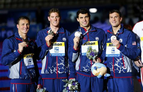 (L-R) Gold medalists Ryan Lochte, Conor Dwyer, Ricky Berens and Charles Gipson Houchin of the U.S. pose with their medals at the men's 4x200