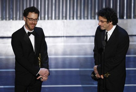 "Ethan (L) and Joel Coen accept the Oscar for best screenplay for ""No Country for Old Men"" during the 80th annual Academy Awards, the Oscars,"