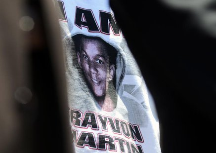 A supporter of the late Trayvon Martin wears a t-shirt bearing his likeness outside a meeting on Florida's 'Stand Your Ground' law in Longwo