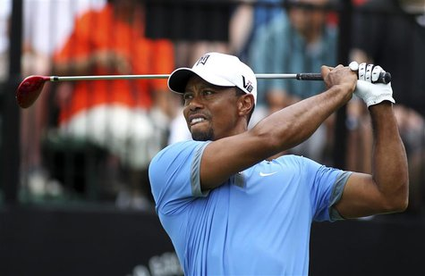 Tiger Woods of the U.S. watches his tee shot on the tenth hole during the second round of the WGC-Bridgestone Invitational golf tournament i