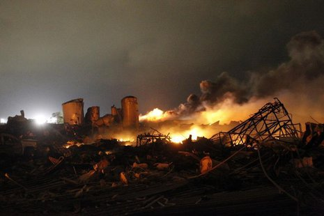 The remains of a fertilizer plant burn after an explosion at the plant in the town of West, near Waco, Texas early April 18, 2013. REUTERS/M
