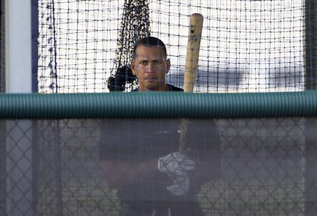 New York Yankees' Alex Rodriguez stands in the batting cage while working out at the teams minor league complex during a rehab assignment in