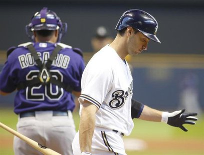 Milwaukee Brewers left fielder Ryan Braun (R) strikes out against the Colorado Rockies during the first inning in a MLB National League base