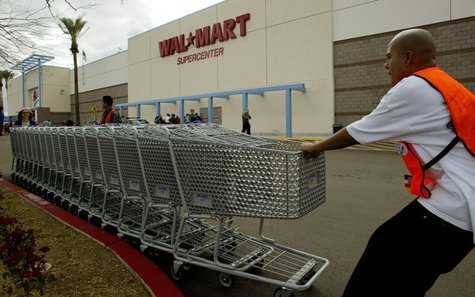 Employees move shopping carts as the first Wal Mart Supercenter to operate in the State of California, opened in La Quinta, California, Marc