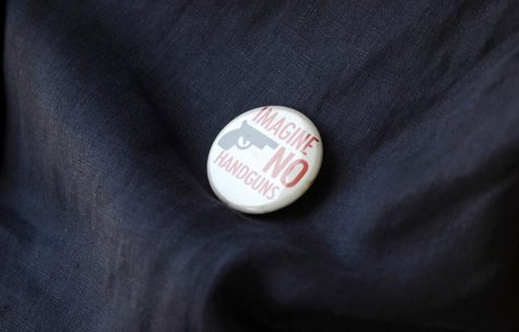An opponent of Florida's 'Stand Your Ground' law wears a button against handguns outside a meeting o the law in Longwood, Florida, June 12,