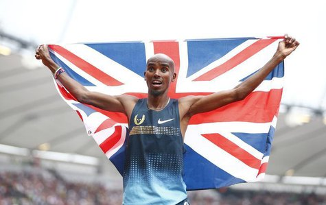 Mo Farah of Britain holds a union flag after winning the men's 3000m at the London Diamond League 'Anniversary Games' athletics meeting at t