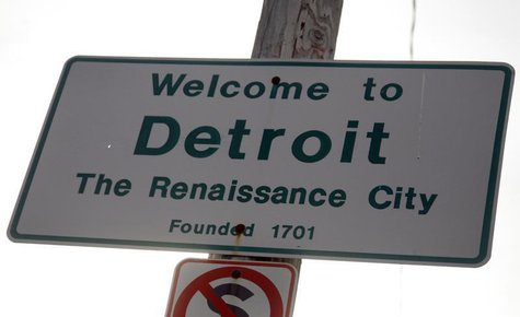 A 'Welcome to Detroit' sign is seen along 8 Mile Road in Detroit, Michigan January 27, 2013. REUTERS/Rebecca Cook