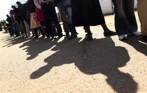Zimbabweans arrive to cast their votes at a polling station in Harare July 31, 2013. REUTERS/Philimon Bulawayo