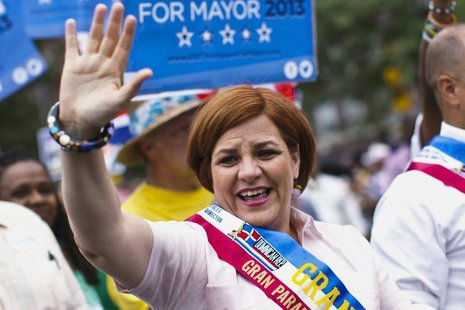 New York mayoral candidate Christine Quinn waves to the crowd while attending the annual Dominican Day Parade in the Bronx, New York July 28
