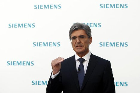 Newly elected Siemens CEO Joe Kaeser gestures during a news conference in Germany's Siemens AG headquarter in Munich July 31, 2013. REUTERS/
