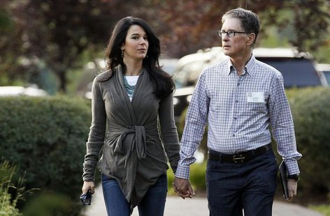Boston Red Sox owner John Henry (R) with wife Linda Pizzuti arrives for the first session of annual Allen and Co. conference at the Sun Vall