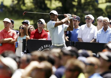 Tiger Woods of the U.S. watches his tee shot on the third hole during the third round of the WGC-Bridgestone Invitational golf tournament in