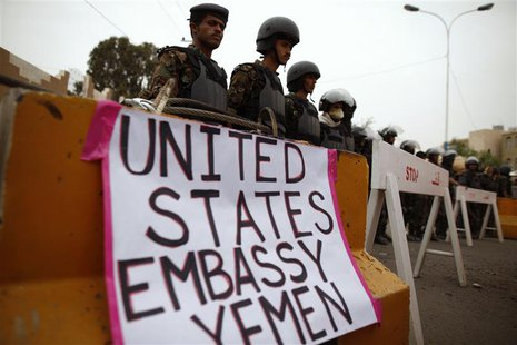 Riot policemen stand guard during a protest to demand the release of Yemeni detainees in the prison of Guantanamo Bay, outside the U.S. emba