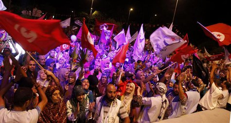 Supporters of the Islamist Ennahda movement wave flags as they chant slogans during a demonstration in support of the Ennahda government and