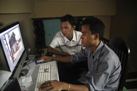 Movie director Zay Par (L) and his editor Zin Thaw work on their movie in the editing room in downtown Yangon July 19, 2013. REUTERS/Jared F