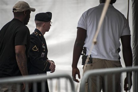 U.S. Army Private First Class Bradley Manning is escorted into court for the second day of the sentencing phase in his military trial at For
