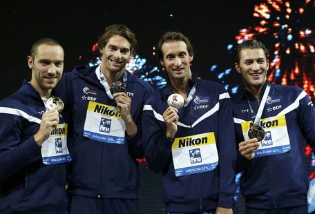 Team France pose with their gold medals at the men's 4x100m medley relay victory ceremony during the World Swimming Championships at the San