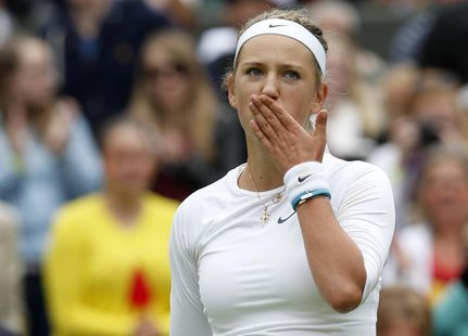 Victoria Azarenka of Belarus blows a kiss after defeating Maria Joao Koehler of Portugal in their women's singles tennis match at the Wimble