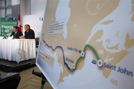 TransCanada President and CEO Russ Girling (2nd L) announces the new Energy East Pipeline during a news conference in Calgary, Alberta, in t