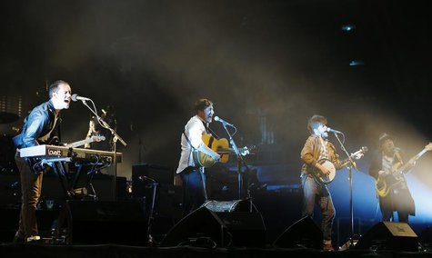 Mumford & Sons, (from L) Ben Lovett , Marcus Mumford, Winston Marshall and Ted Dwane perform on the Pyramid Stage at the Glastonbury music f