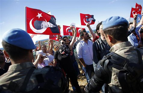 Protesters are blocked by Turkish soldiers as they try to march to a courthouse in Silivri, where a hearing for people charged with attempti