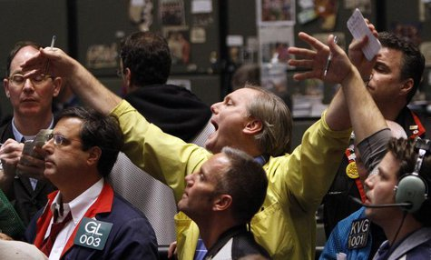 Traders in the S&P 500 options pit at the Chicago Board of Trade signal orders shortly after the Federal Reserve's decision to leave short-t