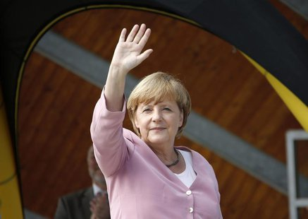 German Chancellor Angela Merkel waves during a Christian Democratic Union (CDU) election campaign rally in Heringsdorf at the Baltic sea Jul