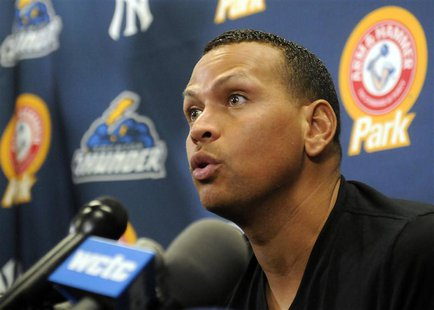 New York Yankee's Alex Rodriguez answers questions at a news conference after playing for the Trenton Thunder in their rehab minor league ba