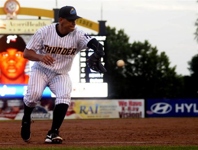 New York Yankee Alex Rodriguez fields a ground ball as he plays for the Trenton Thunder in the third inning of their rehab minor league base