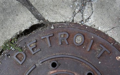 'Detroit' is seen on the top of an iron man-hole cover on a street in Detroit, Michigan July 27, 2013. Detroit, a former manufacturing power