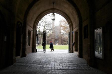A woman walks through the Old Campus at Yale University in New Haven, Connecticut, November 28, 2012. Credit: Reuters/Michelle McLoughlin