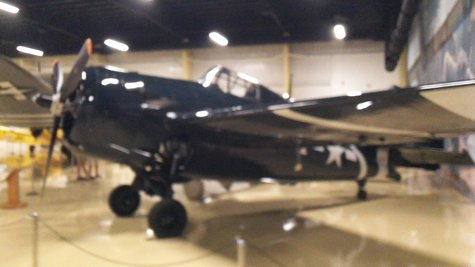 This is the Air Zoo's restored Wildcat, and what the wreck on the Semi will eventually look like.