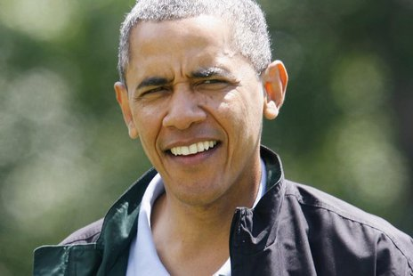 U.S. President Barack Obama smiles as he returns from a birthday weekend visit at Camp David to the White House in Washington, August 4, 201