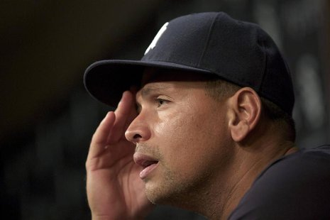 New York Yankees Alex Rodriguez pauses while speaking during a news conference in Chicago, August 5, 2013. Rodriguez, baseball's highest-pai