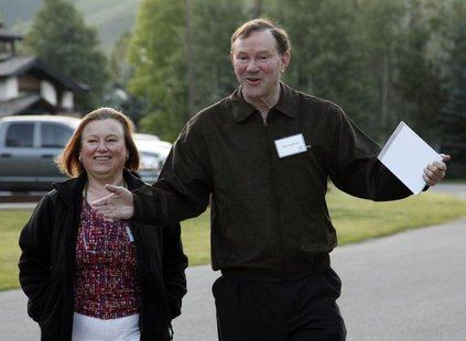 Donald Graham, Chairman and CEO of the Washington Post Co, arrives with an unidentified woman at the Sun Valley Inn in Sun Valley, Idaho Jul