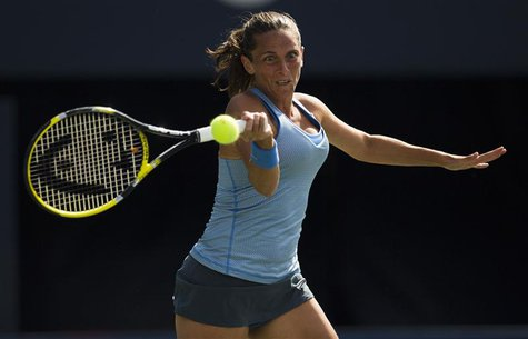 Roberta Vinci of Italy returns a shot to Julia Goerges of Germany during their first round match at the Rogers Cup tennis tournament in Toro