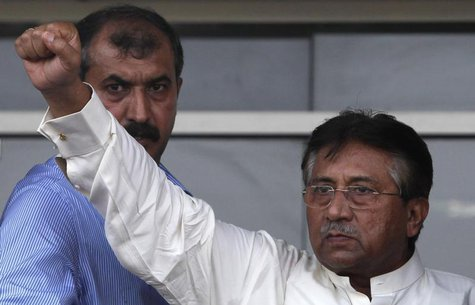 Pakistan's former President Pervez Musharraf gestures to his supporters upon his arrival from Dubai at Jinnah International airport in Karac