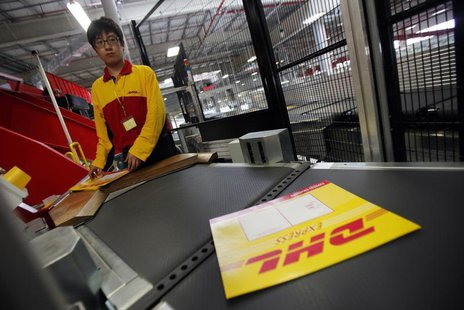 An employee stands at his workstation during a operational test of the new DHL North Asia Hub in Shanghai July 12, 2012. REUTERS/Carlos Barr