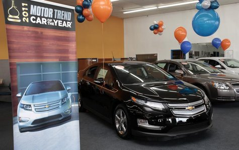 A black 2012 Chevrolet Volt electric car is seen on display in the showroom of George Matick Chevrolet auto sales in Redford, Michigan Janua