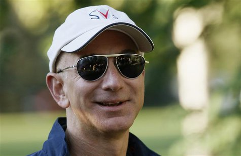 Amazon CEO Jeff Bezos arrives at the annual Allen and Co. conference at the Sun Valley, Idaho Resort in this July 12, 2013 file photo. REUTE