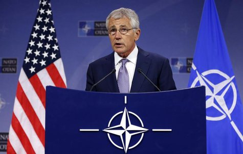 Defense Secretary Chuck Hagel addresses a news conference during a NATO defence ministers meeting at the Alliance headquarters in Brussels J
