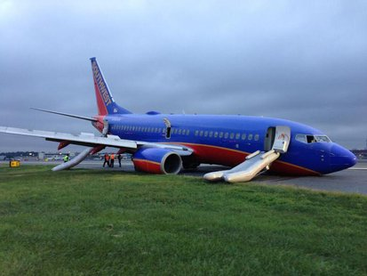 A Southwest Boeing 737 aeroplane sits on the tarmac after passengers were evacuated, at LaGuardia Airport in New York, in this photo courtes