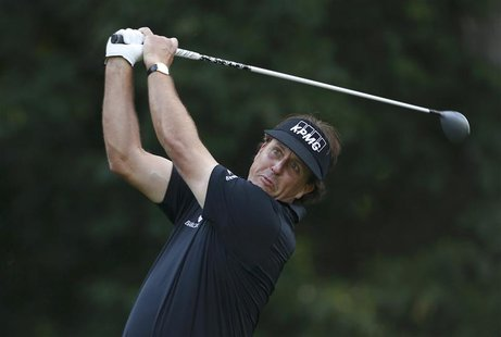 Phil Mickelson of the U.S. tees off on the fourth hole during a practice round for the 2013 PGA Championship golf tournament at Oak Hill Cou