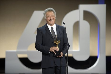 U.S. actor Dustin Hoffman reacts after being presented with a Donostia Award for lifetime achievement at the Kursaal Centre on the final nig