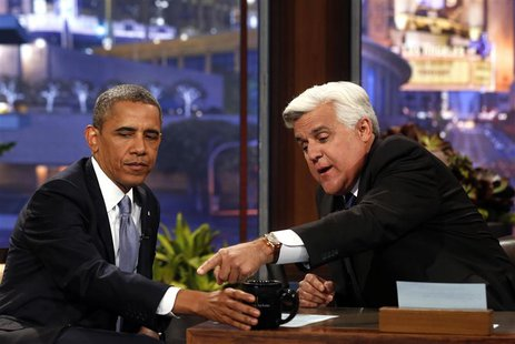 "U.S. President Barack Obama sits next to Jay Leno during the taping of ""The Tonight Show with Jay Leno"" comedy show at the NBC Studios in Bu"