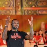 NBA basketball player LeBron James of the Miami Heat gestures as he attends a promotional event at the Imperial Ancestral Temple in Beijing,