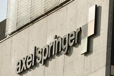 The logo of German publisher Axel Springer is seen at an office building in Zurich July 25, 2013. REUTERS/Arnd Wiegmann